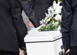 death, casket being carried