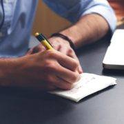 Man writing on paper for life insurance