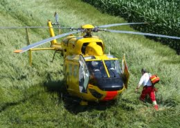Medic entering an air ambulance during a life flight